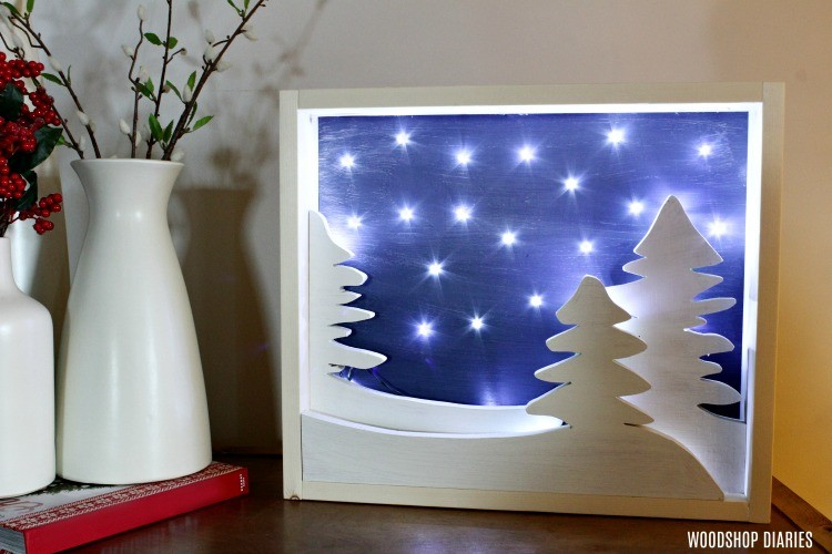 DIY Light Up Christmas Art with battery powered lights and snow trees