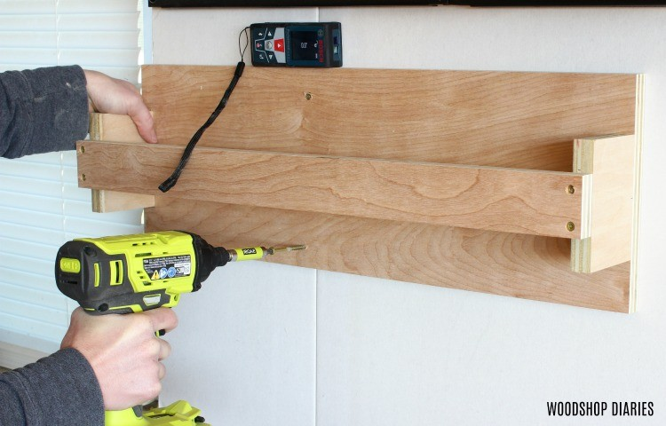 Attach clamp rack to wall driving into studs