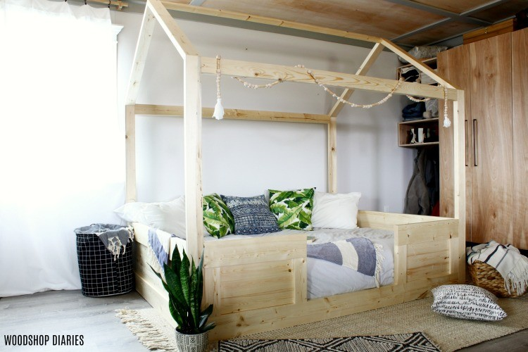 A look at this DIY kids house bed made from construction lumber