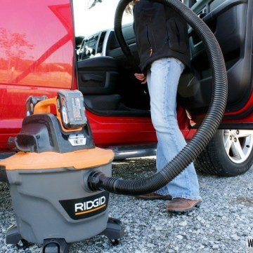Ridgid Cordless Vacuum cleaning out truck