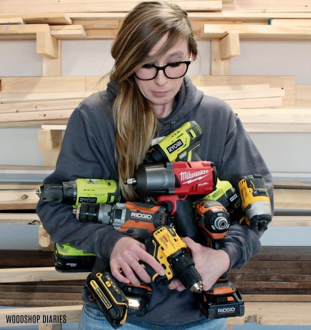 Shara Woodshop Diaries holding armful of drill, driver, and impact wrench