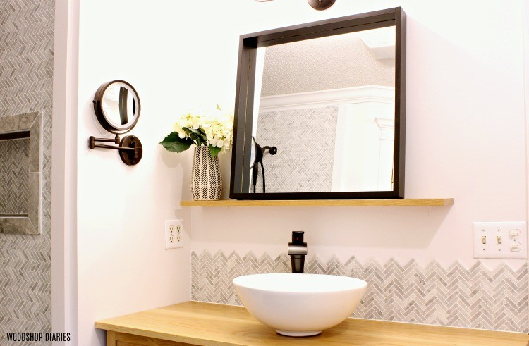 Modern floating bathroom mirror installed during all star renovation challenge