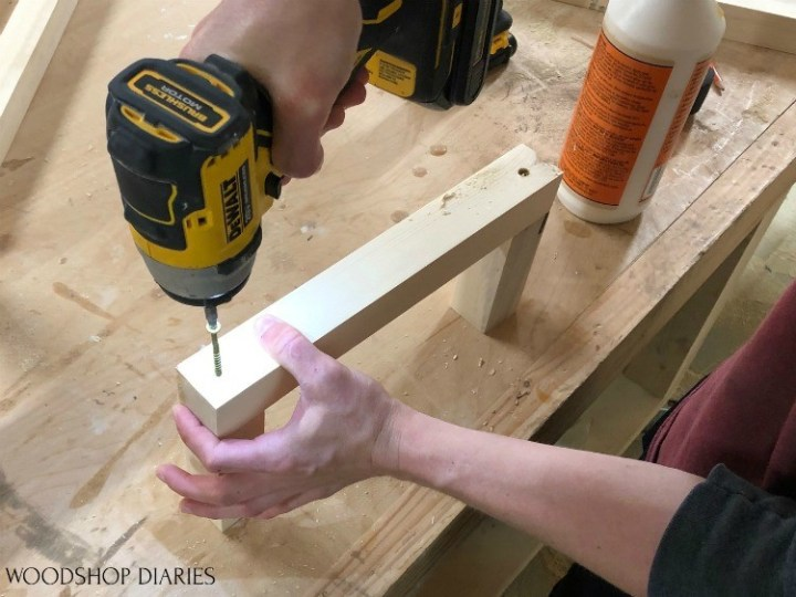 Driving screws into back/side scrap wood towel rack assembly