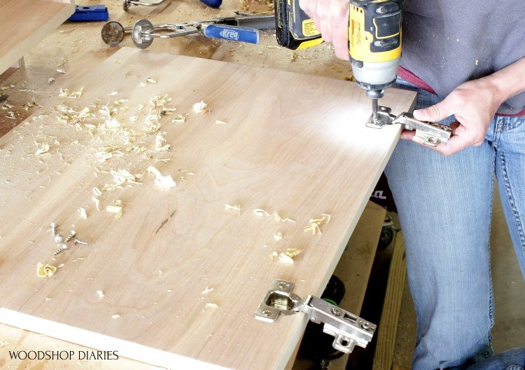 Installing concealed hinge into cabinet door