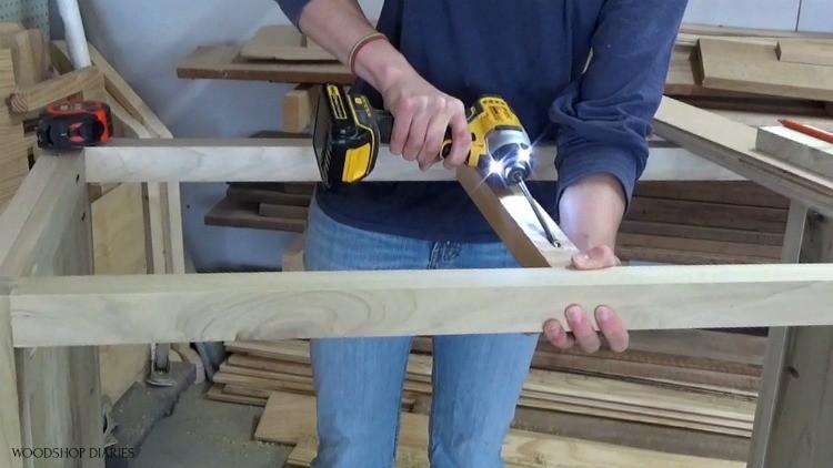 Shara installing 2x2 top frame block to add drawer divider into dresser frame