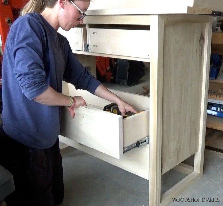 Screwing drawer front onto drawer box from inside to hide the screws