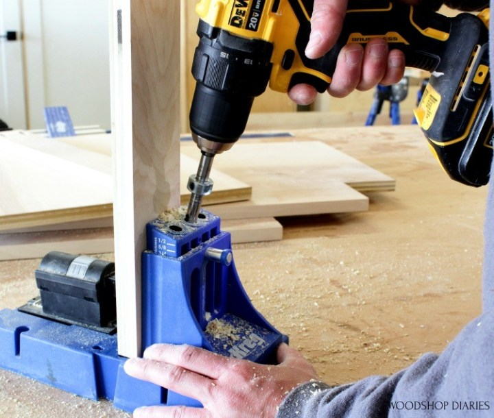 Drilling pocket hole with Kreg K5 into plywood piece to build cabinet