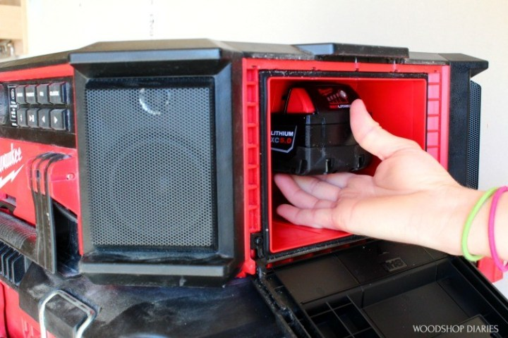 Shara Installing battery pack into weather tight compartment of Milwaukee PACKOUT radio