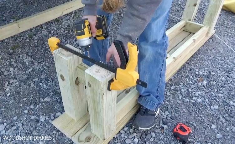Toenailing leg braces at bottom of bench frame