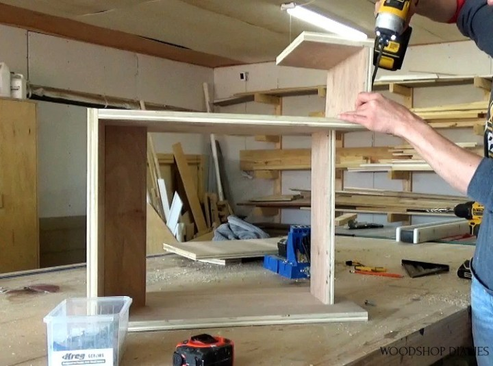 Attach guitar stand section to plywood stool
