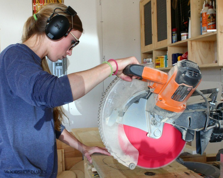 Shara wearing 3M Worktunes while using Miter Saw