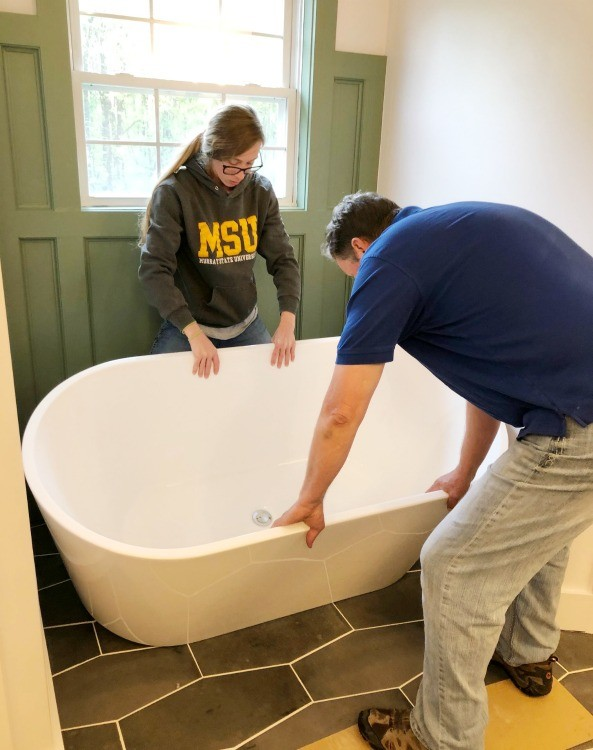 Shara and Dad installing master bathroom stand alone tub