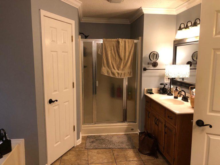 Master bathroom shower door before renovation