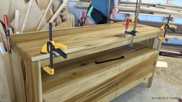 clamping top of modern dresser onto base