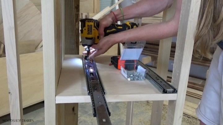 Shara installing drawer slides onto modern dresser