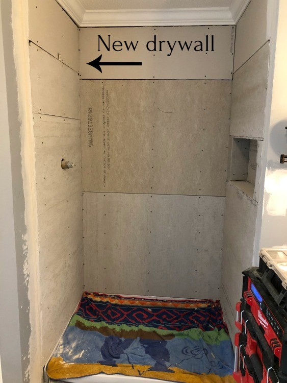 Shower nook with cement board and drywall installed ready for tile