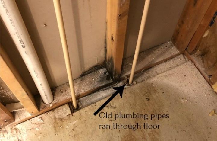 Plumbing lines running up through subfloor