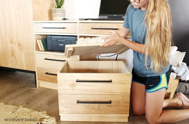 Shara lifting lid on storage seat of dresser desk