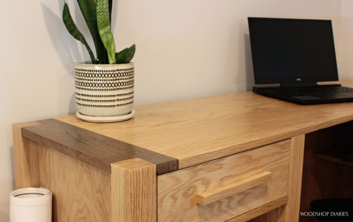 Close up of two tone--walnut and oak--corners on l shaped finished desk