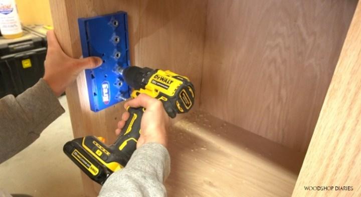 Drill shelf pin holes for adjustable shelves in desk cabinets