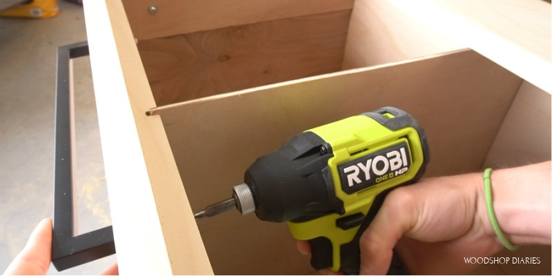 Close up of Ryobi ONE+ HP driver installing drawer pulls in filing cabinet