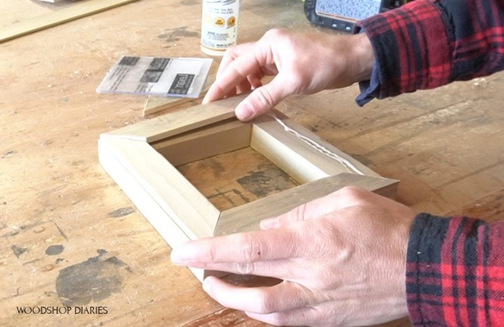 Glue lattice onto back of 1x2 picture frame to install glass