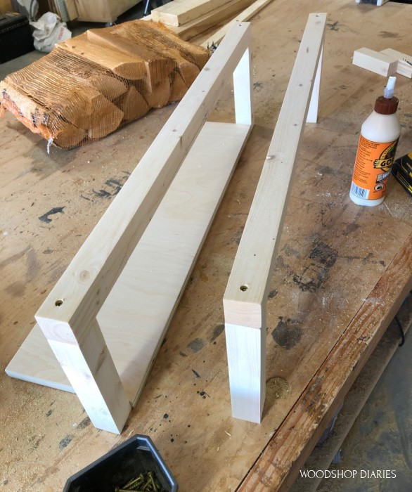 Front rack slats attached to side supports of DIY firewood rack made of 2x2s