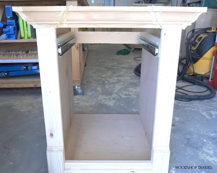 Close up of drawer slides installed into real life cabinet in workshop