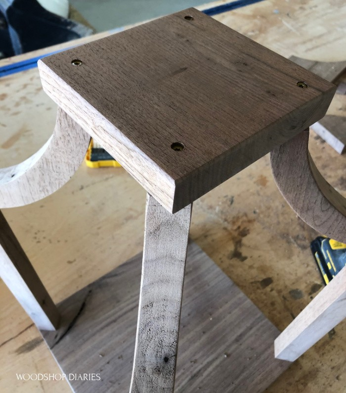 Top plate attached to curved frame of DIy wooden lantern