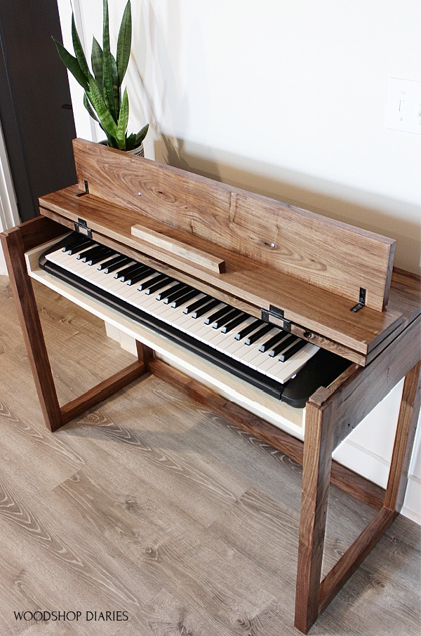 DIY Walnut keyboard stand with top flipped open and keyboard on drawer inside