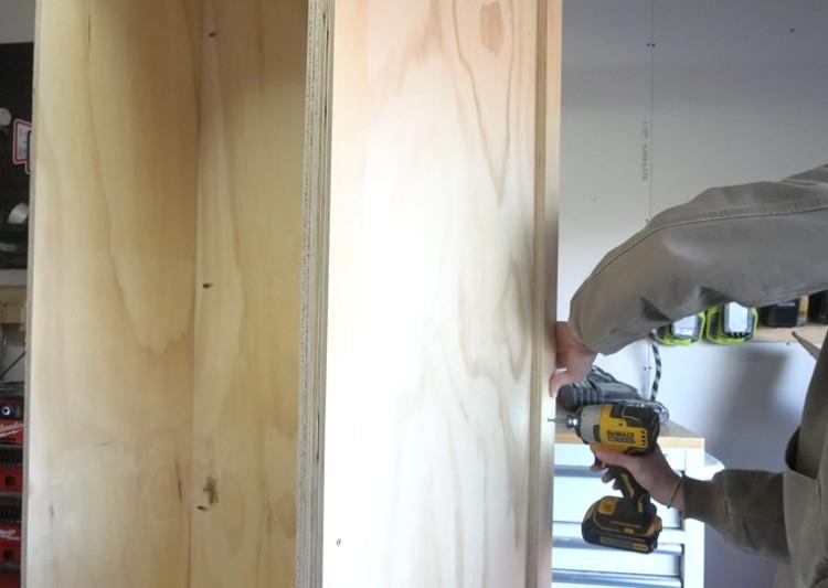 Screw spacer blocks onto cabinet sides