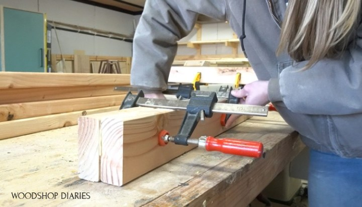 Shara clamping two 2x4s together to make leg posts