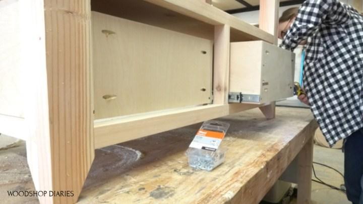 Shara Woodshop Diaries installing drawer boxes into DIY shelf frame
