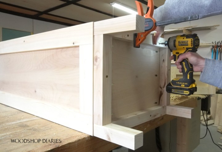 using screws to attach base frame to tall pantry cabinet box