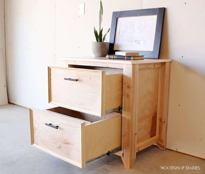 DIY file cabinet made from plywood and 2x4s with drawers open
