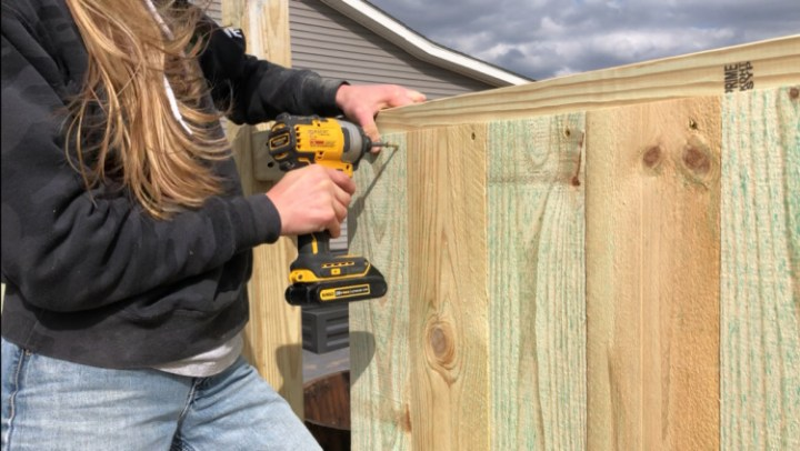 Screwing fence pickets into privacy fence frame