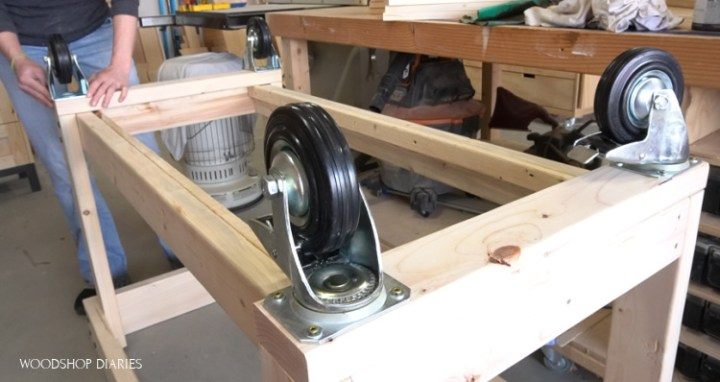 Placing casters on bottom of mobile grill cart