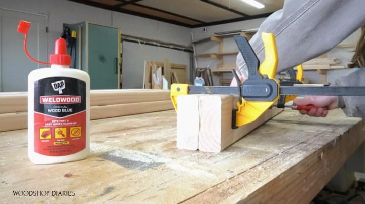 Shara Woodshop Diaries using DAP Weldwood glue to assemble table legs made of 2x4s