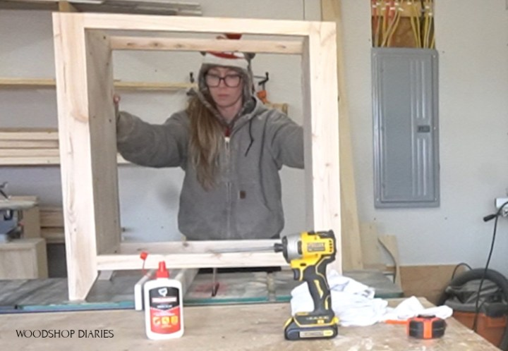 Shara setting cabinet frame on table saw to check for wobble