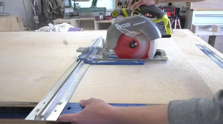 Using a circular saw and rip cut to cut a plywood sheet