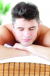 A man relaxes under the professional care of his therapist at Woodstown Massage Boutique; order your 65-minute Massage today!