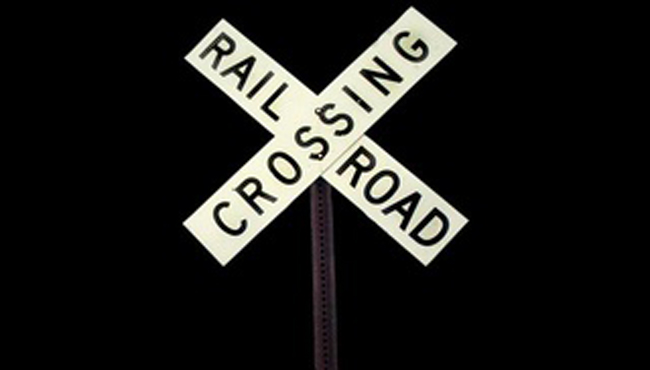 generic railroad crossing generic train_1521079266788.JPG.jpg