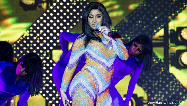 FILE - In this June 16, 2019 file photo, Cardi B performs at the Bonnaroo Music and Arts Festival in Manchester, Tenn. A music festival in Belgium featuring major stars like rapper Cardi B came to a chaotic end before it had even started. Security concerns were ostensibly the reason behind the cancellation of the VestiVille festival in Belgium on Friday, June 28, though local officials have launched a fraud investigation.(Photo by Amy Harris/Invision/AP)