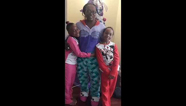 An undated courtesy photo of Ineza McClinton and her twin daughters Faith and Angel.