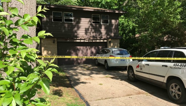 Caution tape surrounds Kentwood home