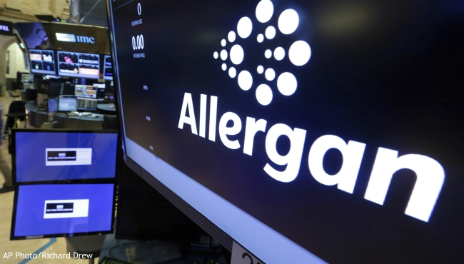 FILE - In this Monday, Nov. 23, 2015, file photo, the Allergan logo appears above a trading post on the floor of the New York Stock Exchange. On Wednesday, July 24, 2019, the medical device maker announced a worldwide recall of its Biocell breast implants which are linked to a rare form of cancer. (AP Photo/Richard Drew, File)
