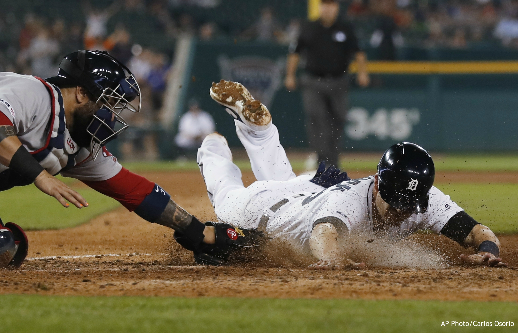 Detroit Tigers' Gordon Beckham beats the tag of Boston Red Sox catcher Sandy Leon to score during the sixth inning of a baseball game Saturday, July 6, 2019, in Detroit. (AP Photo/Carlos Osorio)