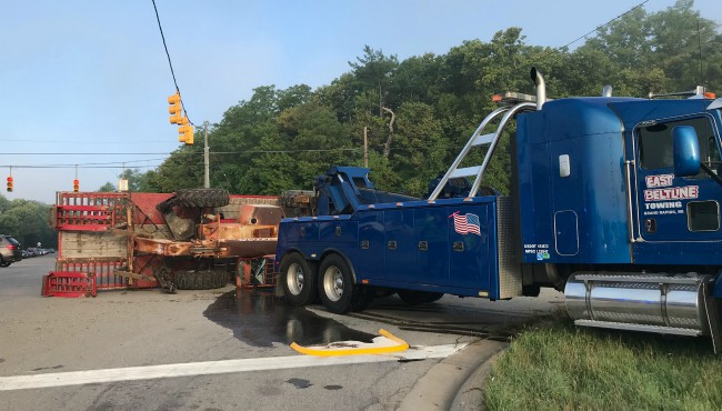 A tipped piece of construction equipment shut down an intersection in Plainfield Township Wednesday, Aug. 21, 2019.
