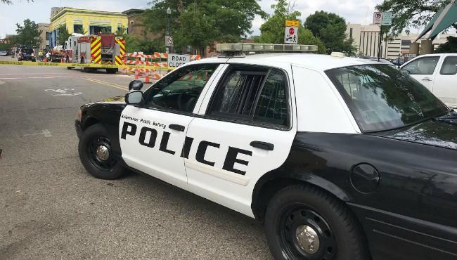 Kalamazoo police cruiser in front of road barricades