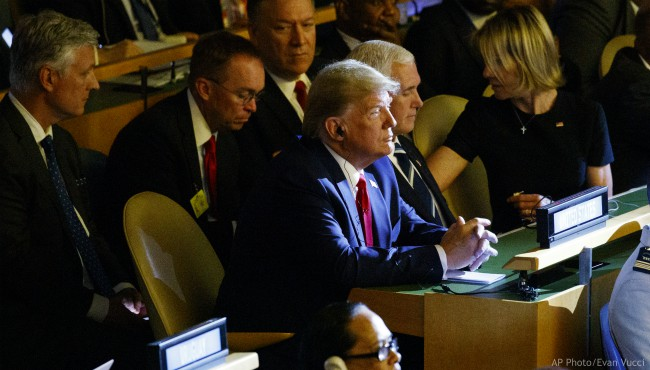 President Donald Trump listens during the the United Nations Climate Action Summit during the General Assembly, Monday, Sept. 23, 2019, in New York. (AP Photo/Evan Vucci)